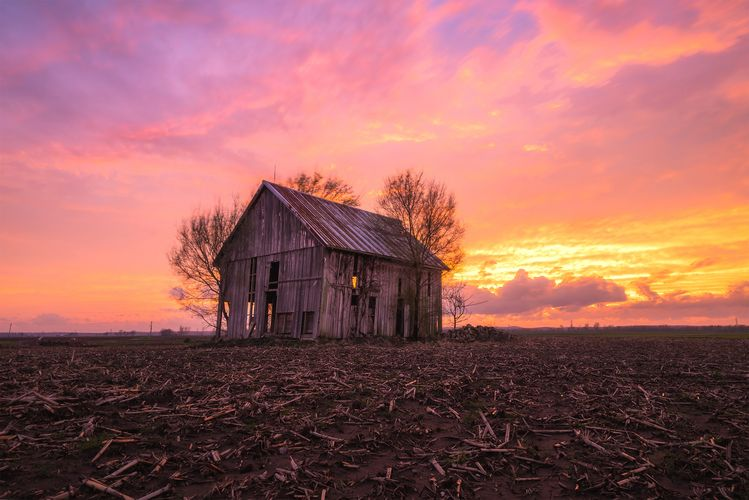 Sunset over a rustic barn on the Illinois countryside March 2020