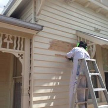 Prepping the weatherboards ready for painting