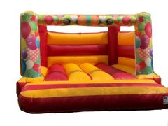 Multi Colour party and balloon theme, low height castle! Ideal 1st time bouncy castle