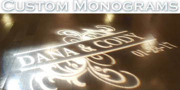 "Captioned picture of a light projecting a custom monogram that reads ""Dana and Cody."""