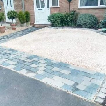 A front garden design to disguise a driveway. A nice bright finish lifts the house. Melksham.