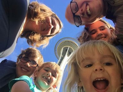 The Guynes family selfie (6 people) with the Seattle space needle in the background.