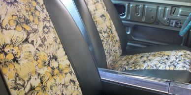 1969 Mod Top Barracuda front seats with OEM floral vinyl inserts