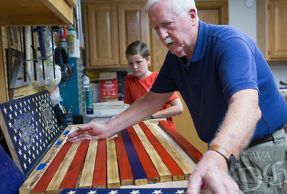 We build a rustic wooden American flag with Police Thin Blue Line.  We do combination flags, too,