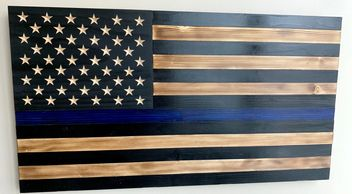 Our beautiful subdued Police Flag with the thin blue line and carved into the wood, not painted.