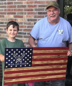Our beautiful U.S. Air Force flag with carved into the wood, not painted.  Shown with Customer and my grandson, Jeremiah.