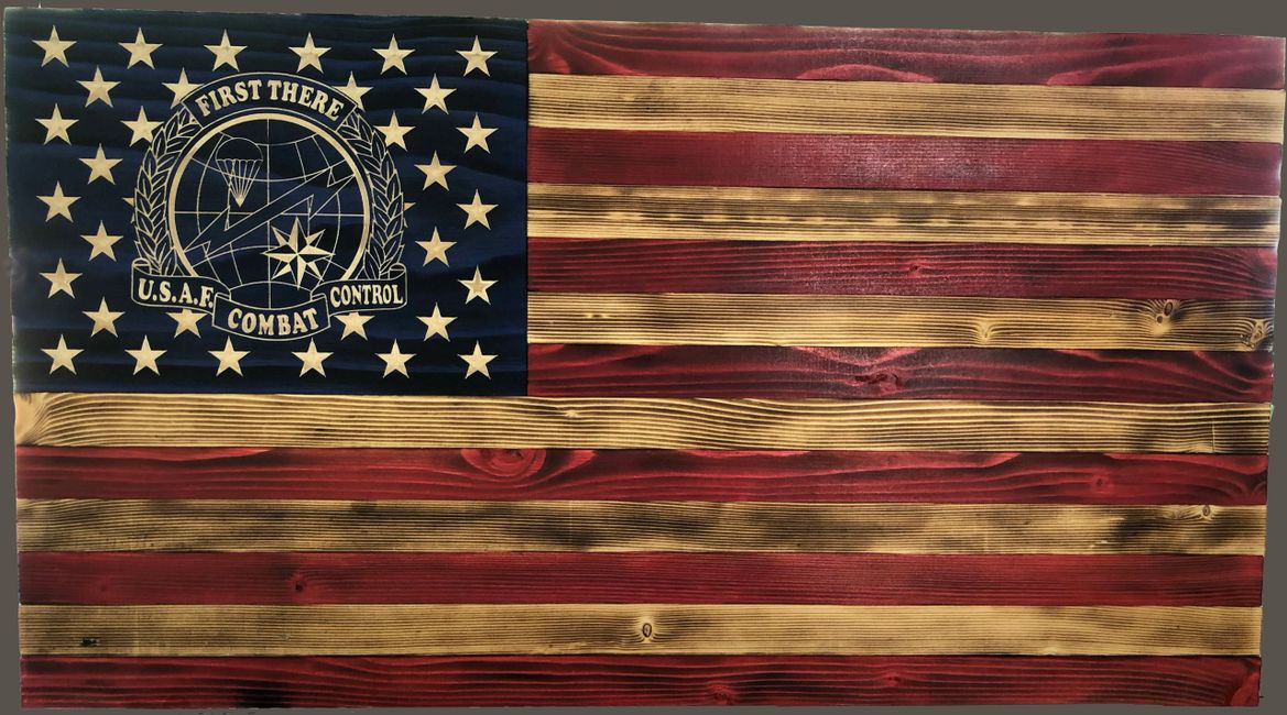 U.S. Air Force Combat Control Flag.  Emblem and stars are carved into the wood.