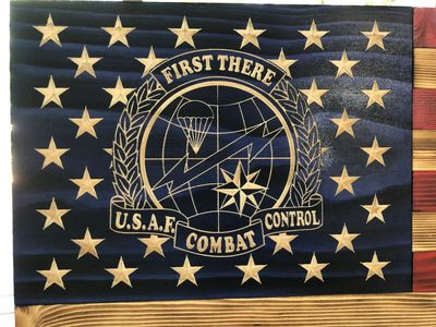 U.S. Air Force Combat Control wooden flag with their emblem carved in detail along with the stars.
