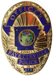 Photo of Fayetteville Arkansas Police Officer Steven Carr's badge that was used to carve the badge.