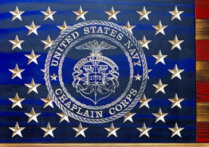 Navy Chaplains flag with their emblem carved into the wood in detail along with the stars.