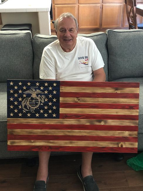Semper Fi Marine Corp Flag with the Eagle, Globe, and Anchor carved into the wood, not painted.