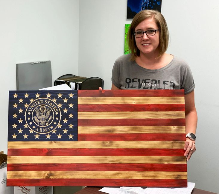 Rustic Wooden US Army flag held by a proud mother in Bella Vista, Arkansas.
