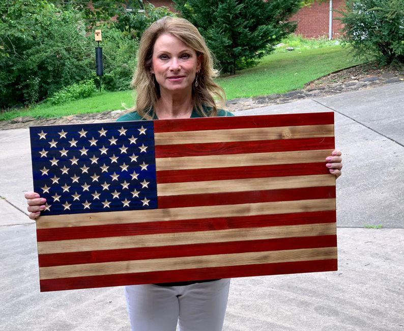 Proud owner is our rustic wooden traditional 50 star flag.