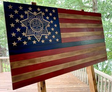 Linn County, Iowa Deputy Sheriff's badge carver in detail into this beautiful rustic wooden flag.