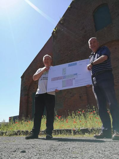 Duncan Mitchell (left) and Brian Robertson with the plans for the flax mill