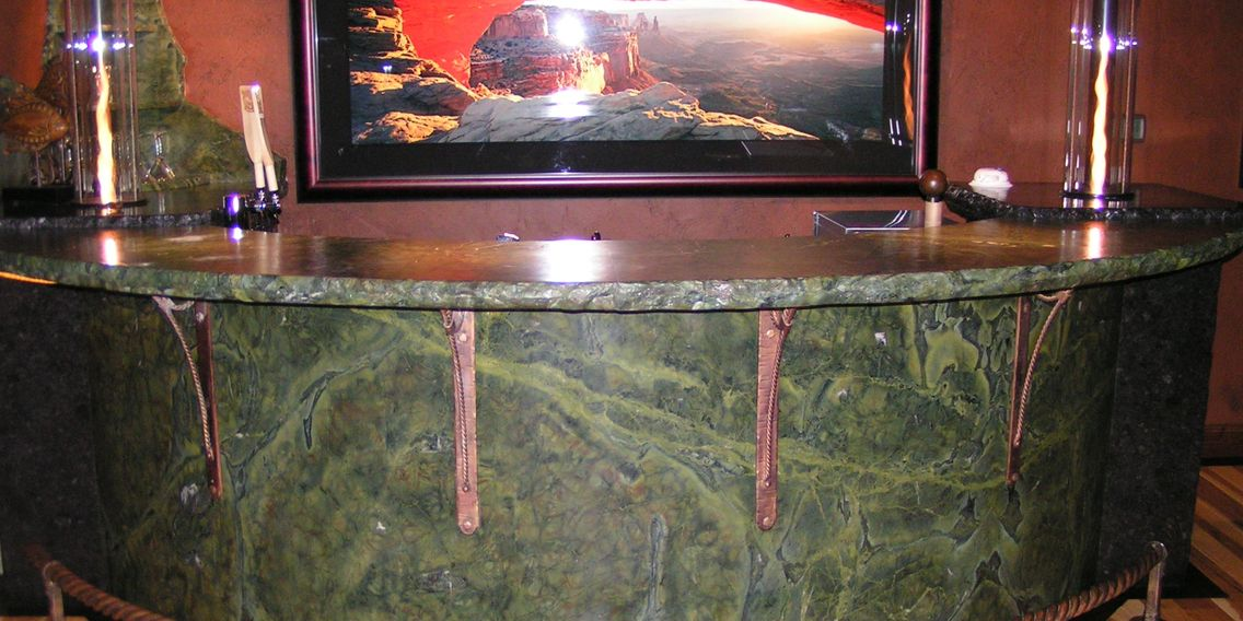 Extreme custom  stone bar with forged metal work.  Granite metal and fire. Made in Montana. ASMT