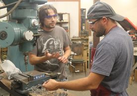 Karl and John at work, World Wide Equine, Glenns Ferry, Idaho USA