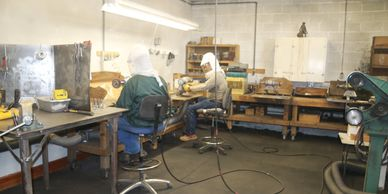 Kiko and Jesus at work in buffing room at World Wide Equine, Glenns Ferry, Idaho, USA