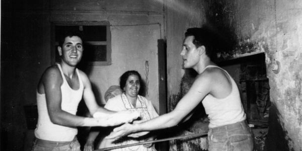Renato(left) his, mother and his brother Toni making bread in the family bakery oven