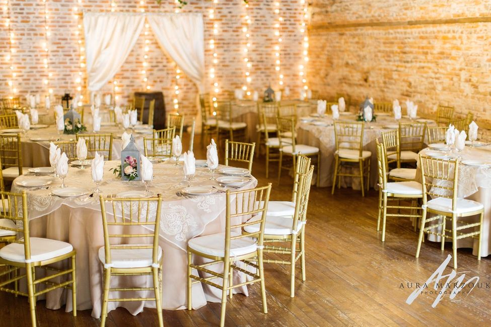 Reception setup at Bakery 1818, main industrial area. Chivari gold chairs with ivory cushions.