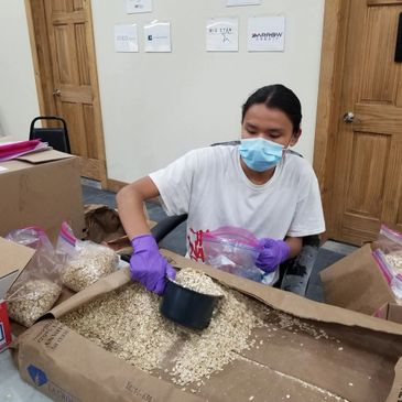 Sicangu CDC volunteer packs supplies for COVID relief kits