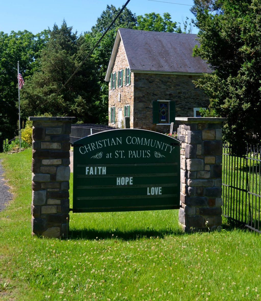 Faith, Hope, and Love sign  in front of the Christian Community Church at St. Paul's.