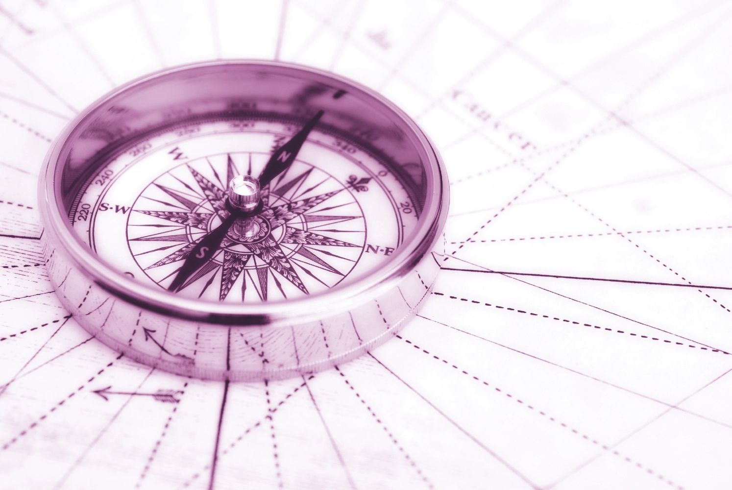 Compass pointing to True North, most common navigation tool for travelers, aimed at fixed point