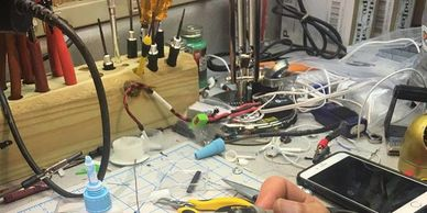 Chris Wood on his fpv hobby bench building a custom fpv earbud