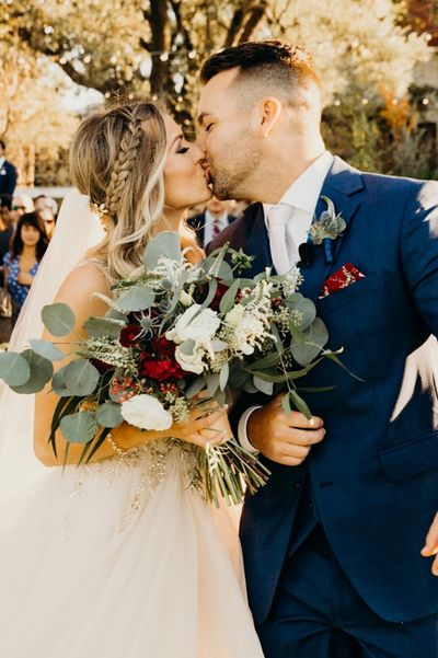 Bride Groom Kissing Bridal Bouquet Red White Eucalyptus