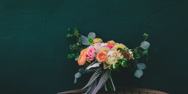 Sarah Kathleen Photography  Sherbert florals with black and white flowing ribbon/