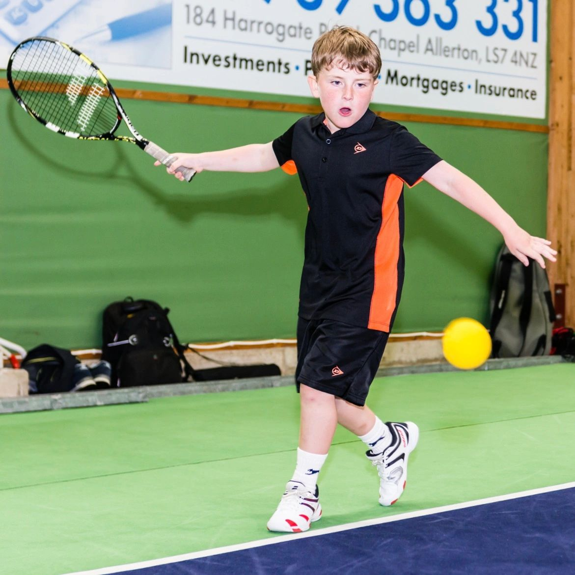 Junior Tennis hitting a tennis ball in Leeds.