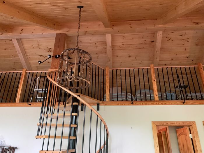 "white knotty pine beams and 8"" tongue and groove with a spiral stair case"