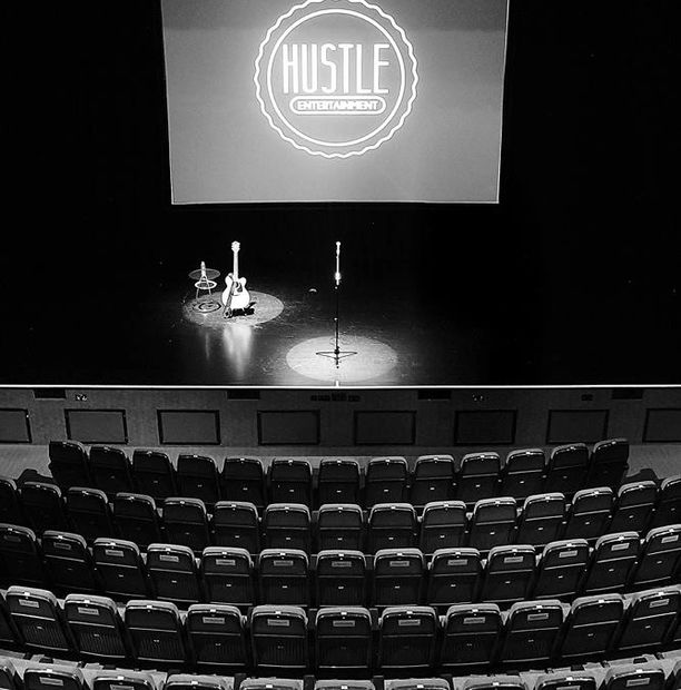 Event Concepts and Execution Stage with Hustle Entertainment Logo