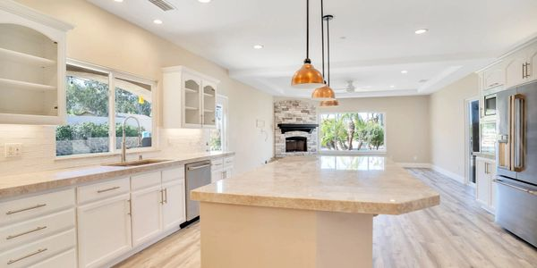 Open Concept Remodeled White Kitchen