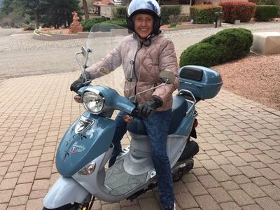 Retired nurse, Penny Mathieu on her scooter