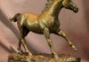 """Freedom"" bronze statue of a Thoroughbred stallion by Kim Corpany limited edition of 50.  17 inches high."