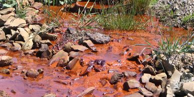 A typical mine-water discharge red/brown through iron oxide salts