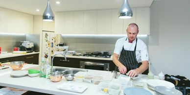 Brett Gilbert of Perth Chef Hire setting up and getting the catering ready for a private home dinner