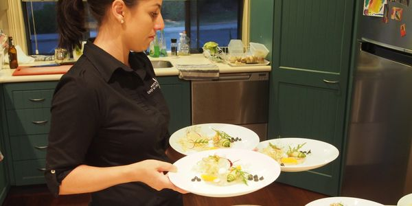 Perth Chef Hire waitress taking one of 5 courses course to the table at a private birthday dinner