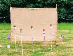 coconut shy herts beds bucks cambs essex london lawn games fete game funfair games hire wedding