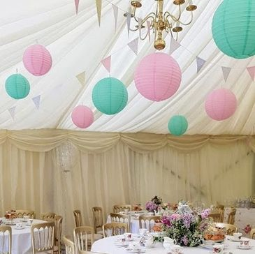 Lantern pinwheel pom pom honeycomb backdrop hire