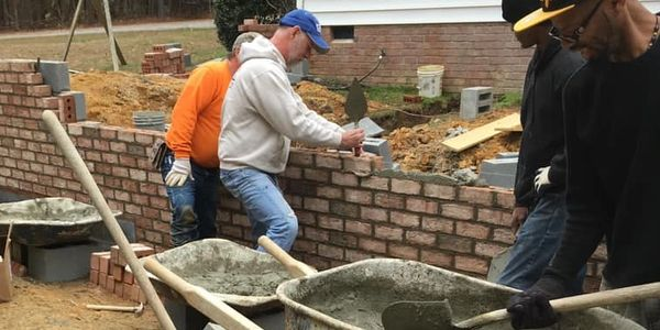 Eppington Homes - Jeff Butler lays the first brick!