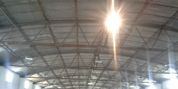 The new roof from the inside right after the exposed lights got turned on.