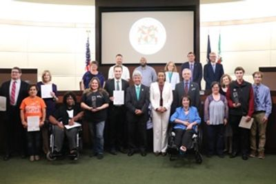 Loudoun County Board of Supervisors & Disability Services Board presenting FAIME awards