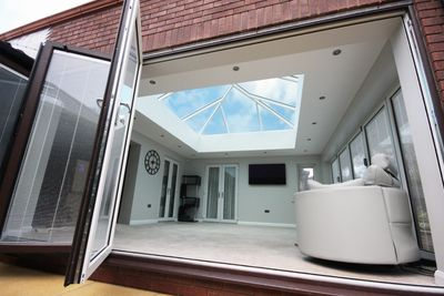 orangery with roof light and bifold doors