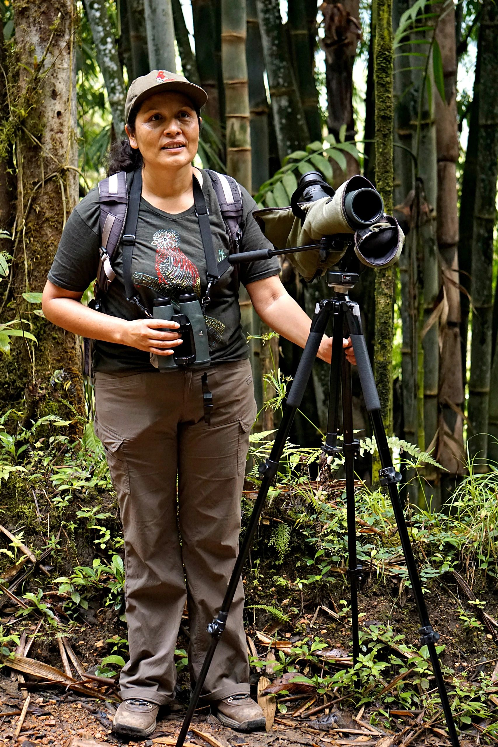 Female bird guide with spotting scope in Mindo, Ecuador.