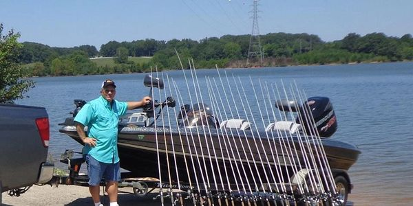 Capt Jake Davis with Duckett Fishing Rods and Triton, ready to take you out for a day on the lake
