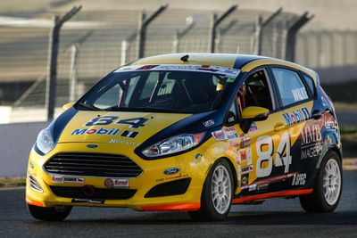 Fritz Wilke in the #84 Fritz Wilke Racing B-Spec Ford Fiesta at Sonoma Raceway in Sonoma California.  Photo taken at Turn 10 during the 2018 SCCA National Runoffs.