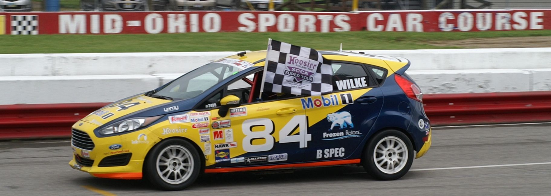 Fritz Wilke wins the 2019 Mid Ohio Hoosier Super Tour in the Fritz Wilke Racing #84 B-Spec Ford Fiesta.  Checkered Flag Lap.