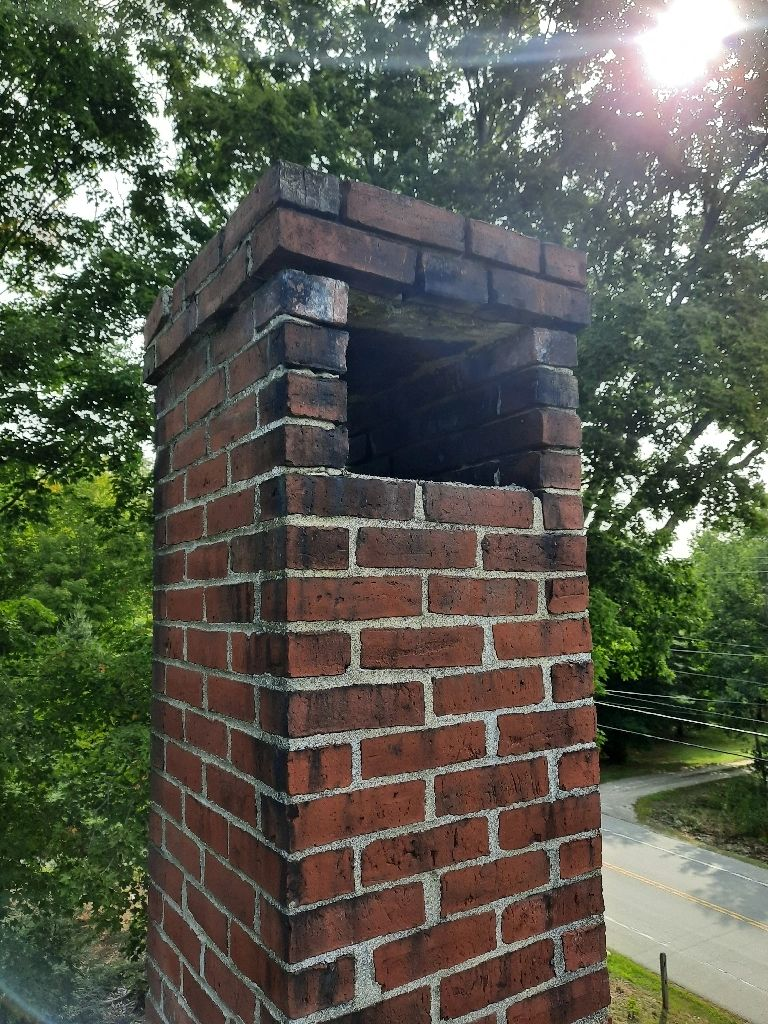 A masonry cap on a chimney in Hampton NH. Photo taken by Anything Chimney.